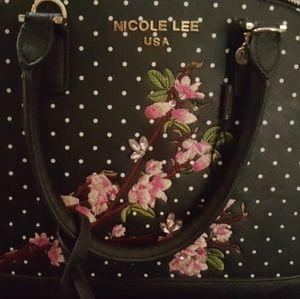 Nicole Lee embroidered purse.